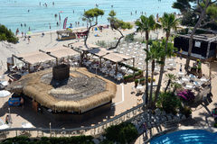 Bar and beach of the Iberostar Alcudia Park in Alcudia Stock Images