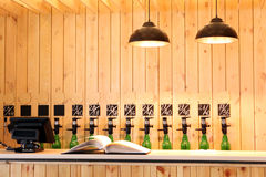 The bar beer spill. Beer Counter. Mass beer on tap. I poured a lot of beer bottles. Large simultaneous spilling beer in the bar. The bar of wood. Wooden desk royalty free stock image