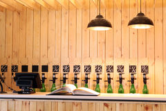 The bar beer spill. Beer Counter. Mass beer on tap. I poured a lot of beer bottles. Large simultaneous spilling beer in the bar. The bar of wood. Wooden desk royalty free stock photos