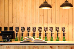 The bar beer spill. Beer Counter. Mass beer on tap. I poured a lot of beer bottles. Large simultaneous spilling beer in the bar. The bar of wood. Wooden desk stock photos
