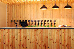 The bar beer spill. Beer Counter. Mass beer on tap. I poured a lot of beer bottles. Large simultaneous spilling beer in the bar. The bar of wood. Wooden desk royalty free stock photo