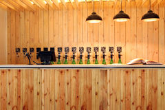 The bar beer spill. Beer Counter. Mass beer on tap. I poured a lot of beer bottles. Large simultaneous spilling beer in the bar. The bar of wood. Wooden desk stock photography
