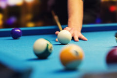 Bar billiard - hand aiming the cue ball Stock Photography