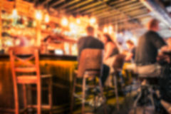 Bar Blur. Defocused pub blur with people at the bar stock photos