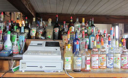 Bar with cash register and bottles in Key West Florida. Royalty Free Stock Image