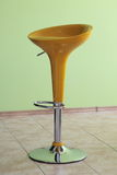Bar chair. Yellow modern chair of bar Royalty Free Stock Images