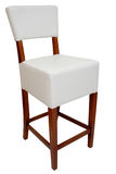 Bar chair. Stool for bar or house use, upholstered in white leather with wooden beech legs colored in cherry Stock Image
