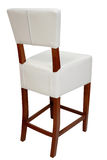 Bar chair. High stool for bar or house use, upholstered in white leather with wooden beech legs colored in cherry Stock Photography