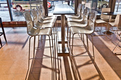Bar chair in early morning light at the Airport. In hamburg Stock Photos