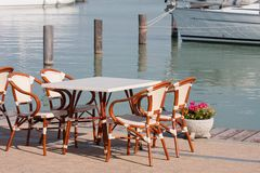 Bar chairs in harbor Royalty Free Stock Images