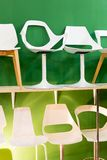 Bar chairs at a modern green backround Royalty Free Stock Photo