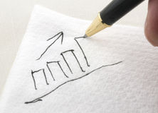 Bar Chart Being Drawn on a Napkin Royalty Free Stock Image