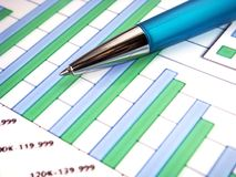 Bar chart with pen and numbers stock photo