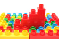 Bar chart of plastic cubes on colorful building blocks. Stack of red building blocks for children, bar chart of plastic cubes lying on colorful building blocks royalty free stock photo