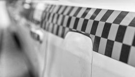 Bar on Chequered Taxi Cab Royalty Free Stock Image