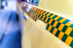 Bar on Chequered Taxi Cab Stock Images