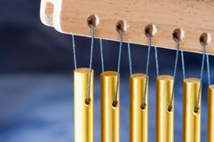 Bar chimes on a blue background Royalty Free Stock Photos