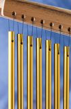 Bar chimes on a blue background. Close up of bar chimes on a blue background Stock Images