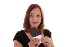 A bar of chocolate. A young woman eating chocolate Stock Image