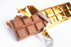 Bar of chocolate. A bar of chocolate with the gold foil pulled open Royalty Free Stock Image