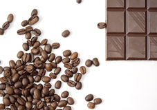 Bar of chocolate and coffee beans Royalty Free Stock Images