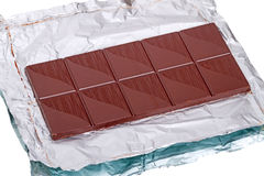 Bar of chocolate on a foil Stock Photography