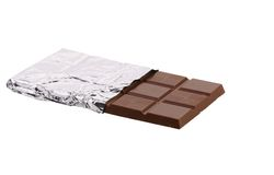 Bar of chocolate in foil. Royalty Free Stock Photos