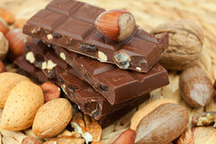 Bar of chocolate and nuts Royalty Free Stock Photography