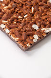 Bar of chocolate with steamed rice on a white background Stock Photos
