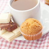 Bar of chocolate,tea and muffin Royalty Free Stock Photos