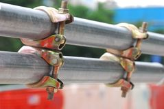 Bar Clamps. Some zinc electroplated bar clamps at a construction site Royalty Free Stock Photos