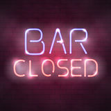Bar closed neon sign on the brick wall Royalty Free Stock Photos