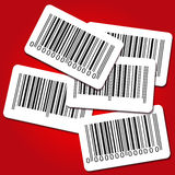 Bar code labels on red background Royalty Free Stock Photography