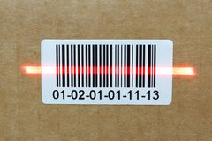 Bar code with laser on carton box.  Stock Photos