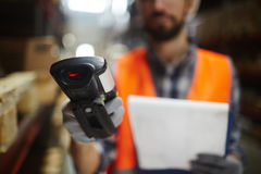 Bar Code Reader. Closeup of bar code scanner in hand of unrecognizable warehouse worker doing inventory of stock stock image