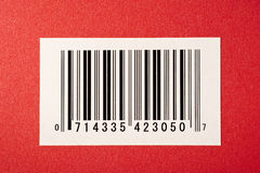 Bar Code On Red Textured Background. A black bar code on a red textured background Stock Images