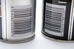 Bar codes on spray cans. A closeup of the barcodes on two aerosol spray cans, one black and one silver Royalty Free Stock Photography