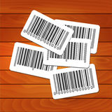 Bar-codes on wooden background Stock Photos