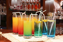 In a bar. Colored glases with a drink in a bar Royalty Free Stock Images