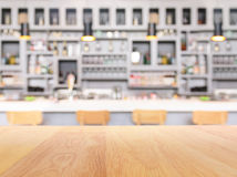 bar counter with bottles in blurred background Stock Images