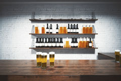 Bar counter front. Front view of wooden bar counter with beer glasses. White brick wall with booze shelves in the background. 3D Rendering Stock Images