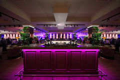 Bar counter with illumination in restaurant Stock Photos