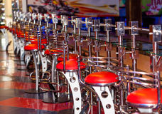 Bar counter with the row of stools Stock Photo