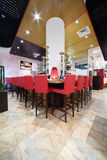 Bar counter with tall red chairs in hall Stock Images
