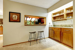 Bar counter top in the wall between kitchen and dining area Royalty Free Stock Photography