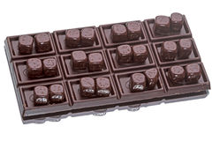 Bar and cubes of chocolate Stock Image