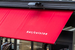 Bar Cuisine on red awning Stock Photo