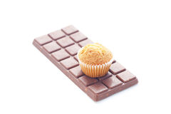 Bar of dark chocolate and muffin Stock Images