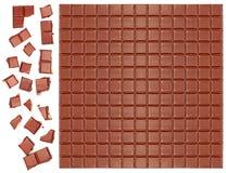 Bar de chocolat du lait avec les parties écrasées Images libres de droits