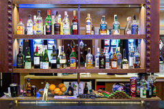 Bar desk with various bottles on it. Casino Tornado, Lithuania. Royalty Free Stock Photo